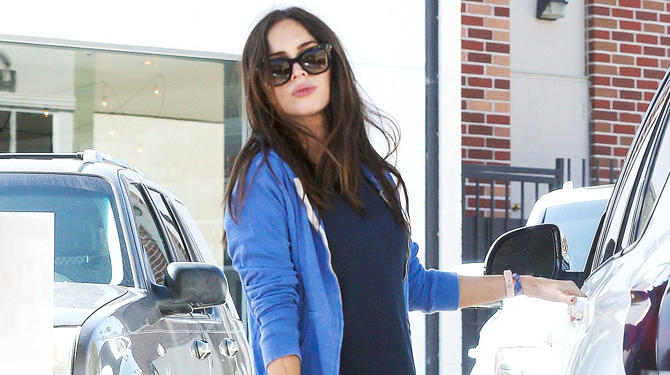 Megan Fox looked radiant and glowing in a simple navy outfit and jacket during a stop at a local yogurt place.