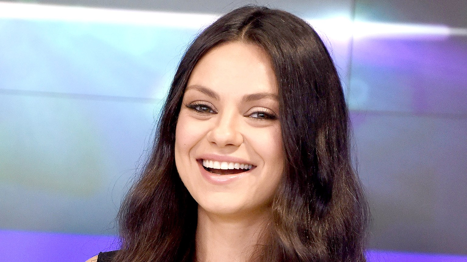 Mila Kunis rings the closing bell at NASDAQ on July 28, 2016 in New York City.