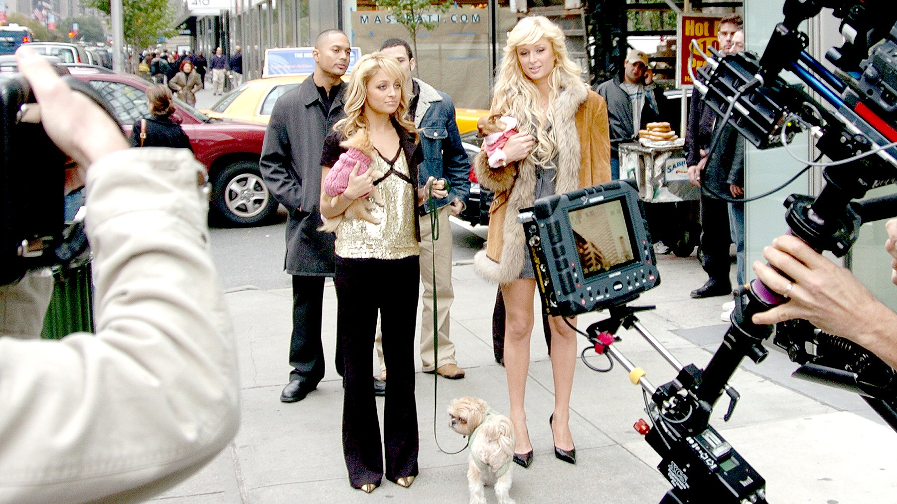 "Nicole Richie (left), Paris Hilton and their pups are on camera at Park Ave. and 55th St. as they film a scene for their TV series ""Simple Life."""