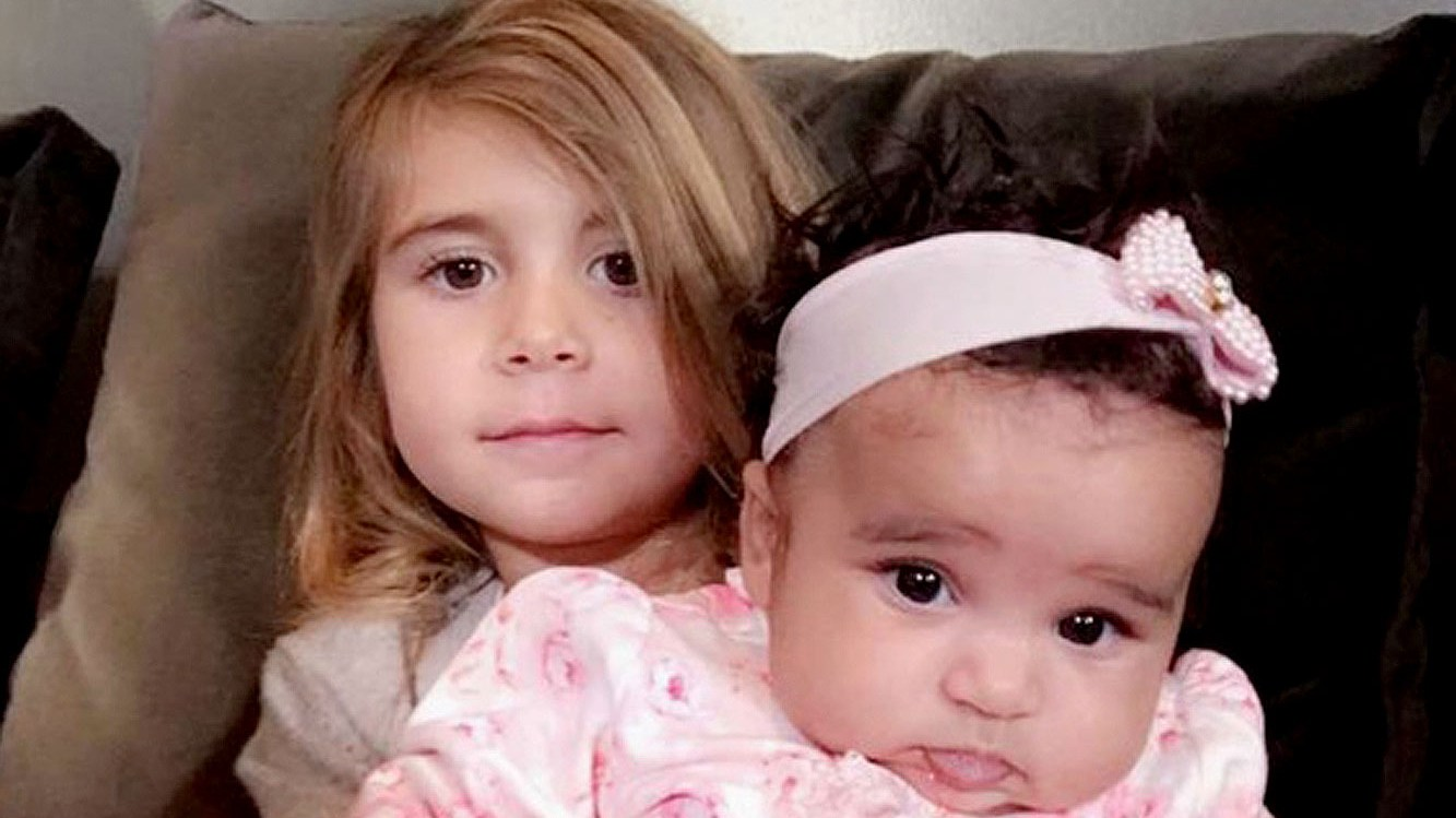 Penelope Disick holds Dream Kardashian in a snap that Rob posted.