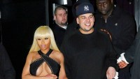 Rob Kardashian holds fiancee Blac Chyna's hand when walking out of ACES strip club in Queens, NY on their first New York appearance together