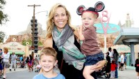 Sheryl Crow and her sons, Wyatt, 5 (left) and Levi, 2, pose at Cars Land in Disney California Adventure park on July 25, 2012 in Anaheim, California.