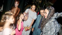 "Suri Cruise, guest, Emily Pynenberg as ""Cassandra"", Katie Holmes, Zac Posen, Leona Lewis as ""Grizabella The Glamour Cat"" chat backstage at the hit musical ""Cats"" on Broadway at The Neil Simon Theatre on August 16, 2016 in New York City."