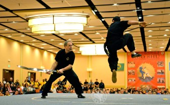 US Martial Arts Academy, Ltd. advanced degree Black Sashes, Shi Fu Paul Jakubowski and fellow disciple of Grandmaster Huang performed double broadsword vs. spear for the Masters Demonstration at the US International Kuo Shu Championship Tournament.