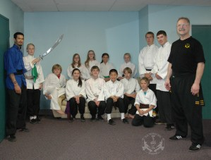 some of the U.S. Martial Arts Academy, Ltd. competitors and Shi Fu Paul at 2012 Grandmaster Huang's Tien Shan Pai Legacy Tournament at U.S. Martial Arts Academy, Ltd. in Timonium, Maryland