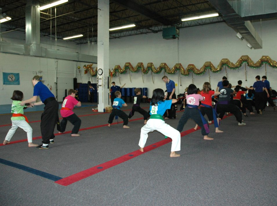 Family Kung Fu class at US Martial Arts Academy, Ltd in Timonium, Md. 7 instructors working with the students and two more also teaching but not seen in picture.