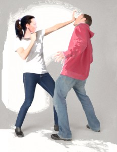 Woman defending herself against a male attacker