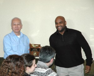Grandmaster Huang giving a competitor award at the 2015 Feb. 22, Chinese New Year luncheon at Tokyo Seafood Buffet, Security Blvd., Windsor Mill, MD. 21244 -- students and staff from U.S. KuoShu Academy, Owings Mills, Maryland, U.S. Martial Arts Gaithersburg, U.S. Martial Arts Academy, Ltd, Timonium, Freedom Martial Arts, Bel Air