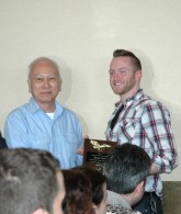 Grandmaster Huang giving an Instructor award at the 2015 Feb. 22, Chinese New Year luncheon at Tokyo Seafood Buffet, Security Blvd., Windsor Mill, MD. 21244 -- students and staff from U.S. KuoShu Academy, Owings Mills, Maryland, U.S. Martial Arts Gaithersburg, U.S. Martial Arts Academy, Ltd, Timonium, Freedom Martial Arts, Bel Air