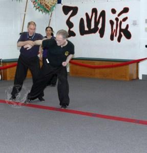 Two man set form practice in Adult Kung Fu class at U.S. Martial Arts Academy, Ltd. Timonium Maryland U.S.A.©2015 Maricar Jakubowski www.usmaltd.com 410-561-9882 All rights reserved.
