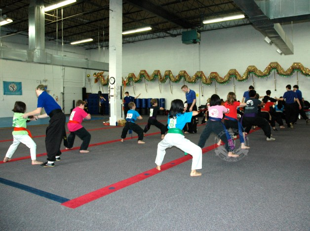 Technique instruction at US Martial Arts Academy, Ltd. Family Kung Fu class with at least 7 instructors working with the students in the class. Two more instructors are also teaching, but are not seen in the picture.
