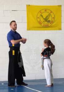 Showing Respect in the Kung Fu Kids Children's Kung Fu Class at US Martial Arts Academy, Ltd in Timonium, Maryland, www.usmaltd.com, 410-561-9882. ©2014 Maricar Jakubowski All rights reserved. No usage allowed in any form without the written consent of the photographer.