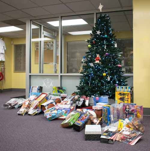 US Martial Arts Academy, Ltd gifts donated for St. Vincent's Villa 2018 Season of Wonder placed under the school Christmas tree