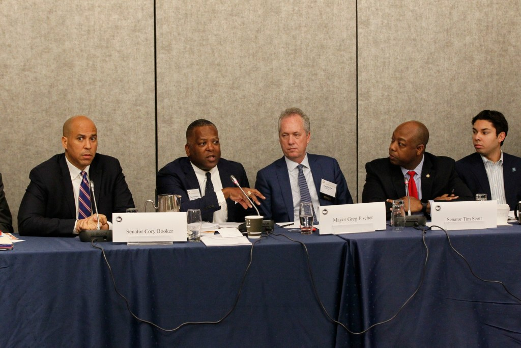 Senator Cory Booker (D-NJ) and Senator Tim Scott (R-SC) discuss opportunity zones at the 86th Winter Meeting on January 24, 2018.