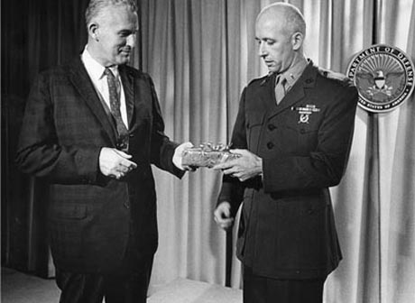 Retirement: CC Major Norm Hatch, in his job as top Photo civil servant in DoD Public Affairs, presents farewell gift to 1stLt Bob McEwen, Oct. 31, 1967
