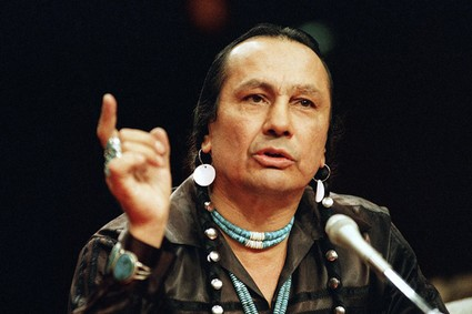 In a Jan. 31, 1989 file photo, Russell Means, who heads the American Indian Movement, (AIM) testifies before a special investigative committee of the Senate Select Committee on Capitol Hill, in Washington. Means, a former American Indian Movement activist who helped lead the 1973 uprising at Wounded Knee, reveled in stirring up attention and appeared in several Hollywood films, died early Monday, Oct. 22, 2012, at his ranch Zzxin Porcupine, S.D., Oglala Sioux Tribe spokeswoman Donna Solomon said. He was 72.