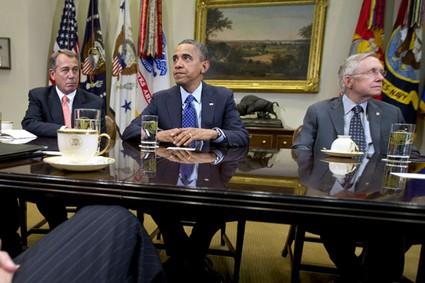 President Barack Obama pauses as he hosts a meeting on Nov. 16, 2012, in the Roosevelt Room of the White House with House Speaker John Boehner and Senate Majority Leader Harry Reid.