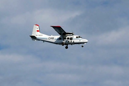 In this photo released by Japan Coast Guard 11th Regional Coast Guard, a Chinese airplane flies in Japanese airspace above the islands known as Senkaku in Japanese and Diaoyu in Chinese in southwestern Japan Thursday, Dec. 13, 2012. A Japanese government spokesman said a Chinese airplane has been spotted in Japanese airspace above the islands controlled by Tokyo but also claimed by Beijing. The Defense Agency said four Japanese F-15 jets headed to the area which has been at the center of a territorial dispute Thursday morning, but no further action was taken.