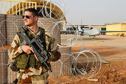 This photo taken Feb. 20, 2013 and released on March 6, 2013, by the French Army Communications Audiovisual office (ECPAD) shows a French air force soldier mounting guard near a Hartford drone, at the Niamey military base, in Niger.