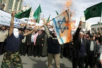Jordanian demonstrators burn an Israeli flag and shout slogans in Amman, Feb. 23, 2007.