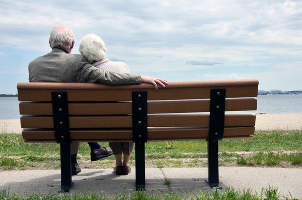 Senior Couple Sitting On The Park Bench