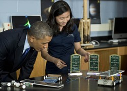 President Barack Obama speaks with student Anh Ly about her robot project during a visit to Manor New Technology High School on May 9, 2013.