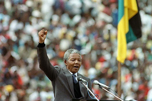 Nelson Mandela addresses a rally of more than 100,000 people at Soccer City Stadium in Johannesburg, South Africa, on Feb. 13, 1990, two days after leaving prison.