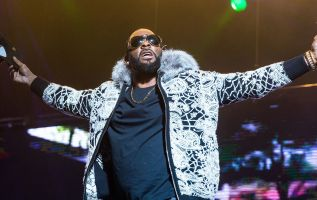 R. Kelly charged with multiple counts of sexual abuse of a minor 3