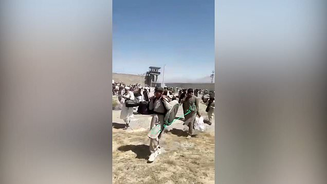 Prisoners, including al Queda and Isis fighters, walk free from Kabul prison after being released by Taliban