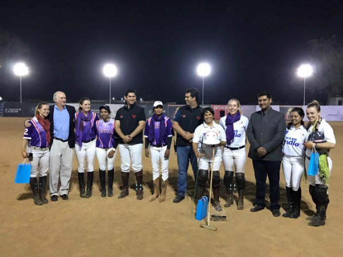 Team USPA and Nasr-India, each team composed of two Team USPA players and two Indian women's players, pose with Nasr Polo members and Steven Armour (USPA Governor at Large).
