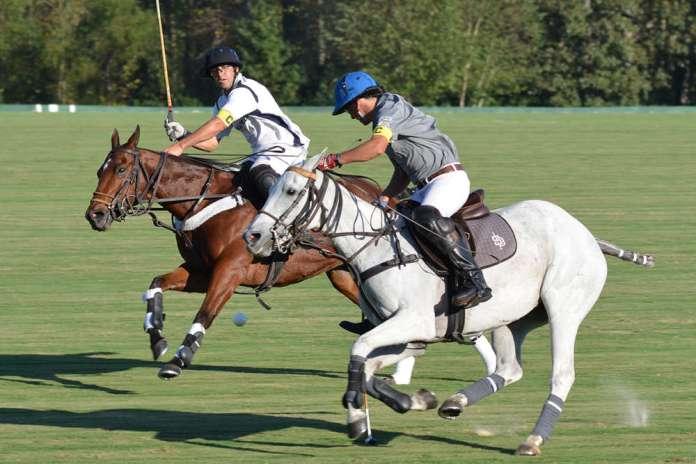 SD Farm's Peco Polledo carries the ball at speed riding BPP Torcasa, Skaneateles' Mariano Obregon in pursuit.