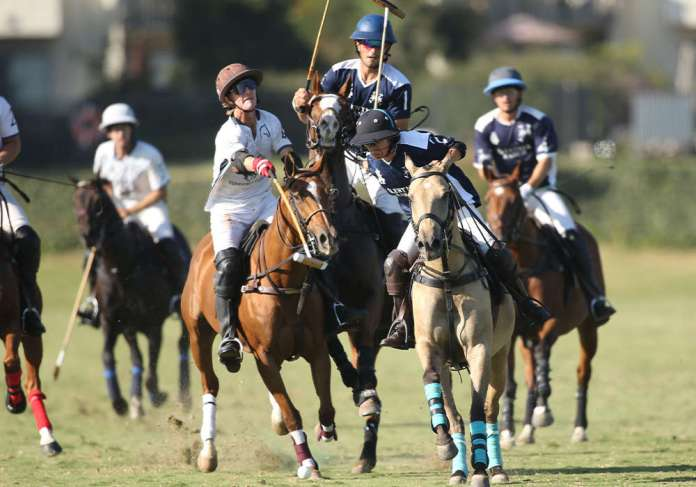Rancho Polo/Chogan's Jason Crowder extending for the ball in front of Klentner Ranch's Dominique Mielle.
