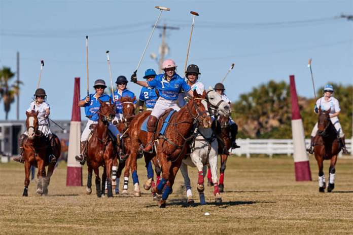 South Padre Island Polo Club's Abi McVaney with San Antonio Polo Club's Ursala Lipari on her hip.