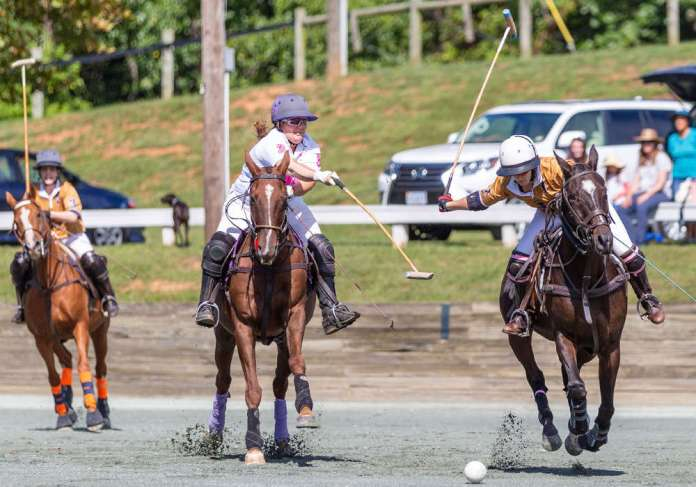 Bad Ass Polo's Demitra Hajimihalis attempts to block the shot from La Jefa's Katie Mitcham.