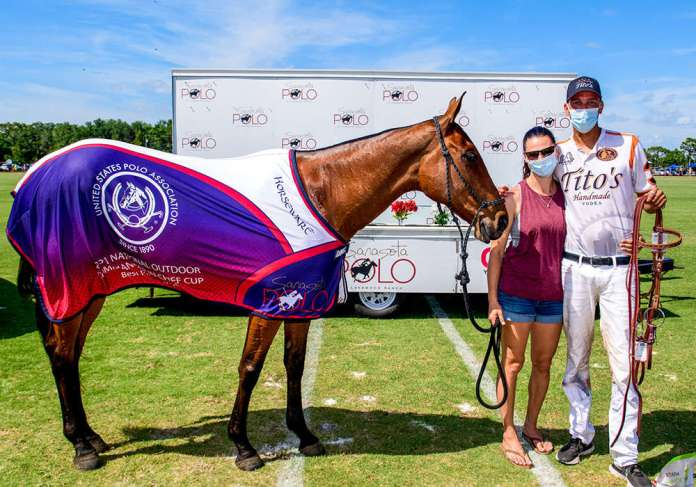 Best Playing Pony Phoenix, played during the third chukker by Alan Martinez. Pictured with Rebecca Von Schweinitz.