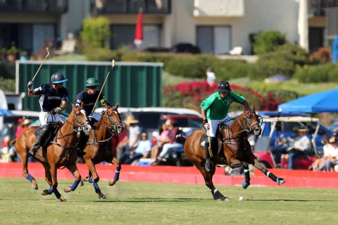 Most Valuable Player Farmers & Merchants Bank's Santiago Toccalino on a breakaway with Lucchese's Jeff Hall and Jorge Cernadas in pursuit.