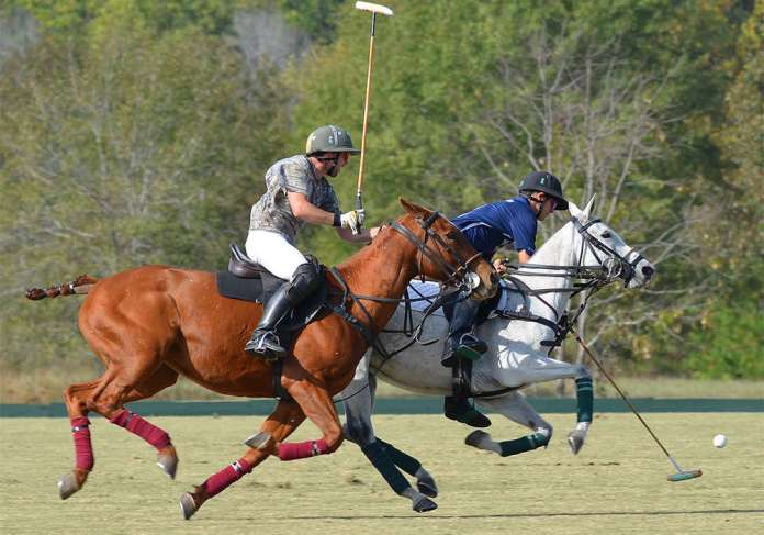 Skaneateles' Joaquin Panelo takes a nearside shot, with Foxdale Equine's Nicolas Saenz on his hip.