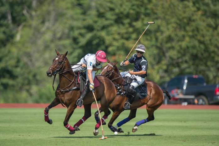 Work to Ride's Gringo Colombres carries the ball on the nearside, Iconica's Peke Gonzalez on defense.