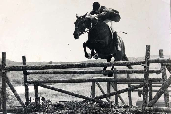 """Judith Baker and Nobeark, who she bought at a racetrack in Mexico, made herself and competed in England, shown jumping a 5'3"""" oxer fence."""