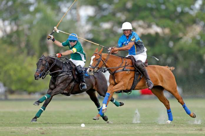 Sapo Caset and Popular race down field at top speed against GSA's Matias Magrini during the 2018 Ylvisaker Cup at International Polo Club Palm Beach.