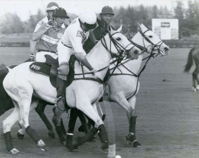 In the January 14 - Sunshine League game between Barrington Hills and BellSouth Mobility, Mike Sparks hit the ball as both Robert Evans and Bart Evans look on.(43362) ©Museum of Polo web