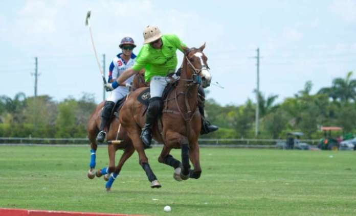 Julio Gracida of ChukkerTV goes for the big hit downfield with Lucas Diaz Alberdi of Sebucan defending
