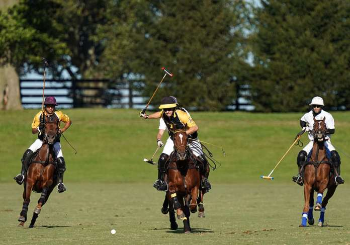 Competition in the 14-goal Kentucky Cup final at Mt. Brilliant Polo LLC. ©Mathea Kelley