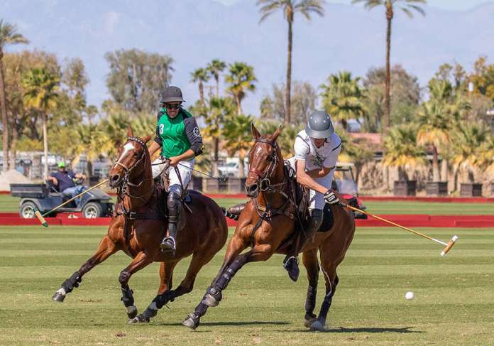 Luna Polo's Diego Larregli on defense as Exit Consulting's Ashton Wolf carries the ball on the nearside.