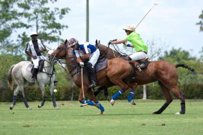 Lucas Diaz Alberdi of Sebucan works near side with Julio Gracida of ChukkerTV defending.