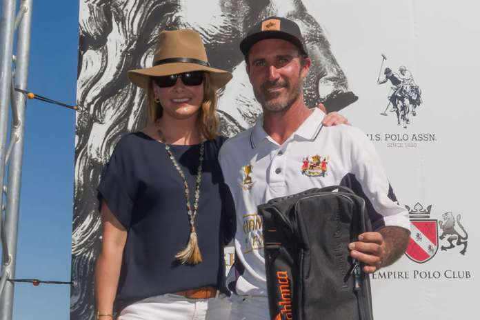 Melissa Kelly of Lockton presents the MVP trophy to Luis Saracco.