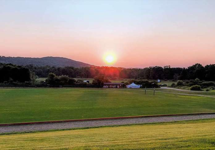 NYC Polo Clubs' pastoral oasis showcases brilliant sunsets. ©Karen Dymersky