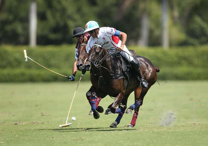 Scone's Adolfo Cambiaso playing the ball ahead of Pilot's Facundo Pieres.
