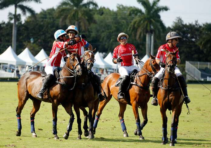 Adolfo Cambiaso celebrating with son Poroto after capturing the 2021 USPA Gold Cup®.