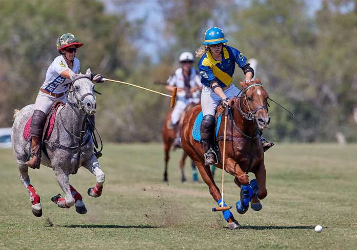 Stephanie Massey Colburn and Lauren Sterr in action at Two Wishes Polo Club.